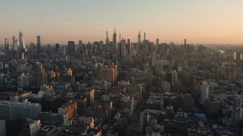 Aerial view of Manhattan Midtown buildings, early morning, skyline with skyscrapers on horizon, light effect applied. New York city | Shutterstock HD Video #1039439993