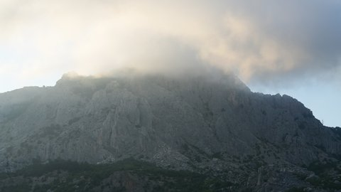 Clouds float on top of a mountain in Crimea
