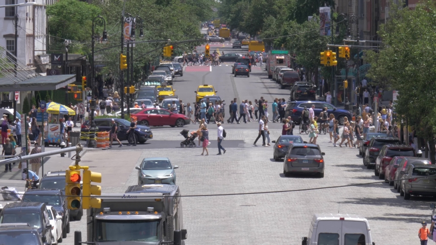 New York City , New York / United States - 06 08 2019: Traffic at the intersection of West 14th Street and 9th Avenue in Chelsea, Manhattan, New York City, filmed in 180 fps slow motion from the High
