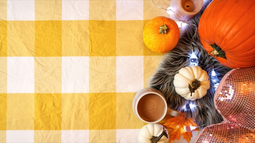 Happy Thanksgiving hygge style on trend autumn in bed flat lay with pumpkins, woman holding hot chocolate drink and letter board with Giving Thanks messsage stop motion reversing to copy space. | Shutterstock HD Video #1039477811