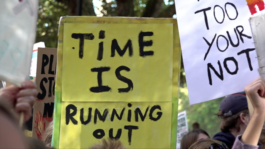 "London / United Kingdom (UK) - 09 20 2019: A placard is held up that says ""Time is running out"" 