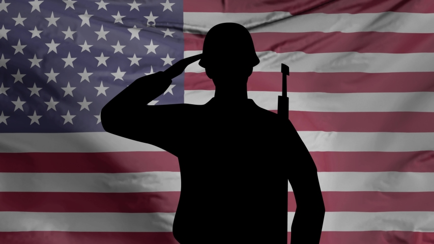 Veterans Day, Honoring all who served. Soldier in front of American Flag. Animated footage.