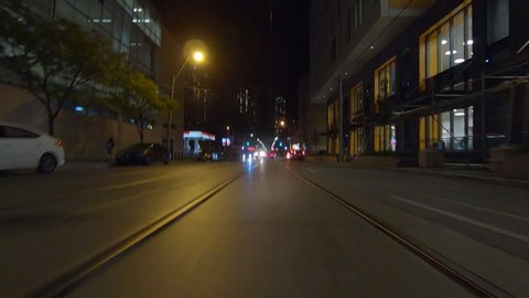 Toronto, Ontario, Canada October 21 2019 Driving plate POV forward low angle at night in downtown city streets