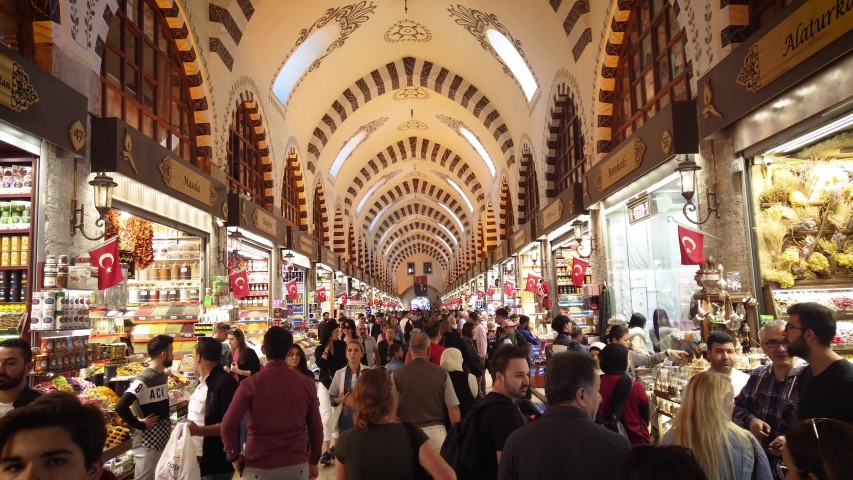 Istanbul, Turkey - October 2019: The shops and crowds of people inside the Egyptian Spice Bazaar of Eminonu district, the old city of istanbul
