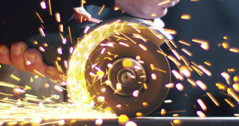 Blacksmith or welder,with its grinding smooths steel and iron | Shutterstock HD Video #1039532657