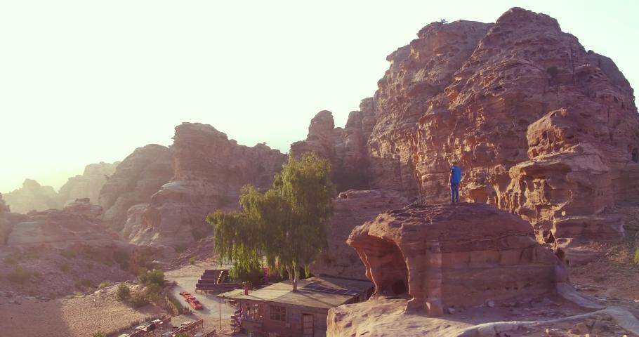 PETRA, JORDAN - CIRCA 2019 - good aerial of a man standing and looking at the Monastery Building in Petra, Jordan.