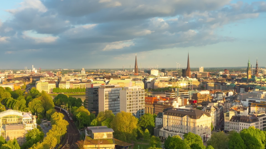 Timelapse of hamburg city center from day to night aerial view zoom out