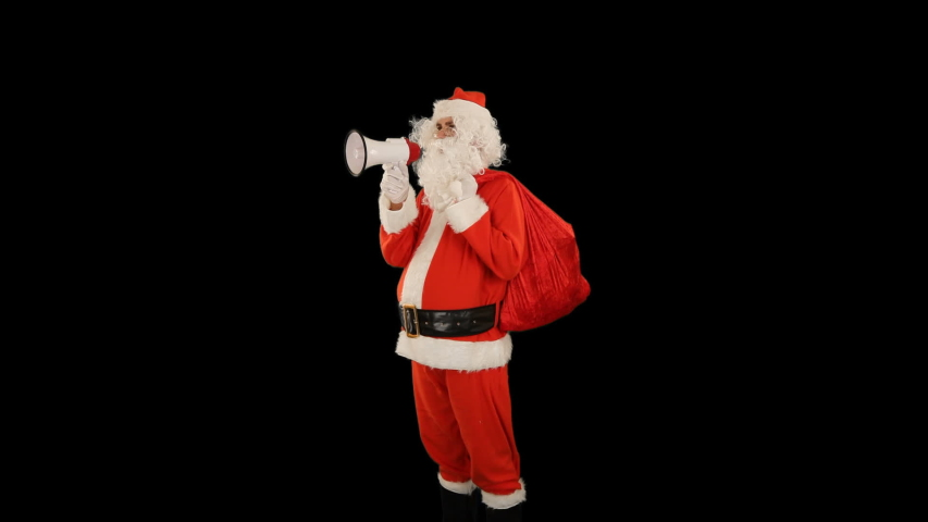 Santa Claus with a bag full of presents shouting through a bullhorn, close up, against black | Shutterstock HD Video #1039576559