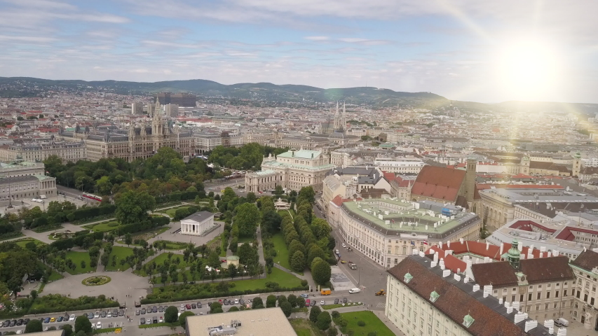 Aerial view of Vienna in the rays of the setting sun. Heldenplatz, Rathaus, Volksarden and university of Vienna skyline aerial shot. Cathedrals and cityscape City of Vienna, Austria.