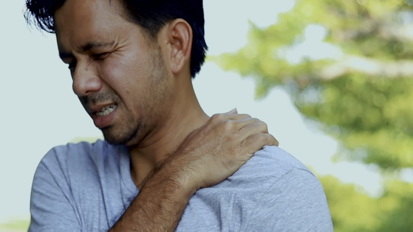 young man suffering from shoulder pain, healthcare concept #1039603718