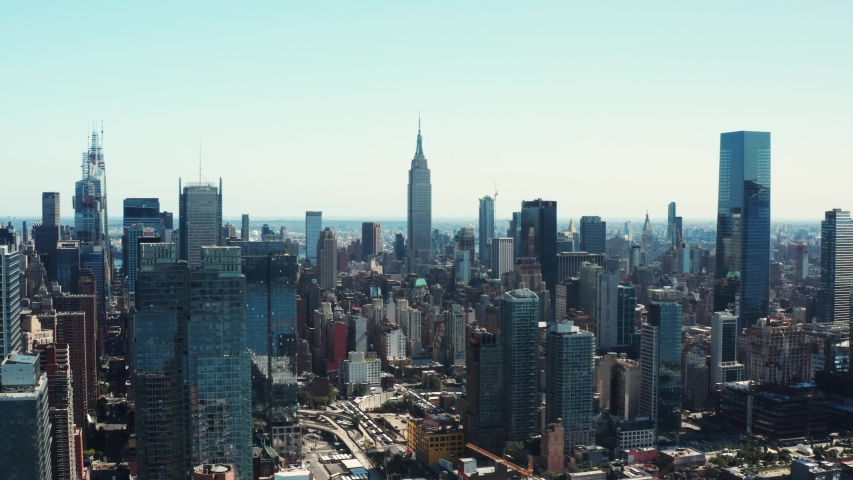 High aerial of Manhattan, drone shooting of New York City, skyscrapers and landmark buildings, famous cityscape: New York, NY/USA - 09 10 2019