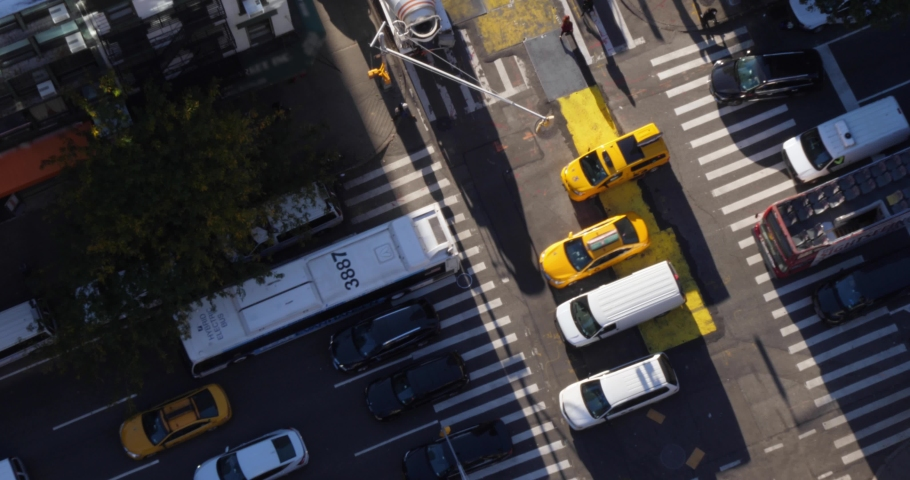 A high angle view of pedestrians and traffic on 6th Avenue in midtown Manhattan.  	 | Shutterstock HD Video #1039632893