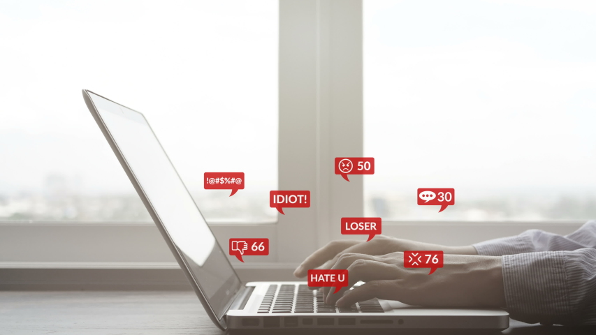 4K. people using notebook computer laptop for social media interactions with notification icons of hate speech and mean comment in social network, cyber bullying concept. Royalty-Free Stock Footage #1039639655
