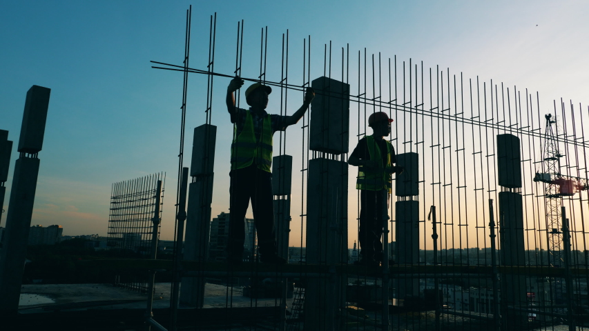 Building workers are constructing a metal framework