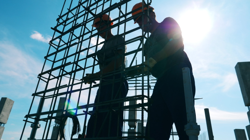 Building workers are making a metal carcass outdoors | Shutterstock HD Video #1039651148