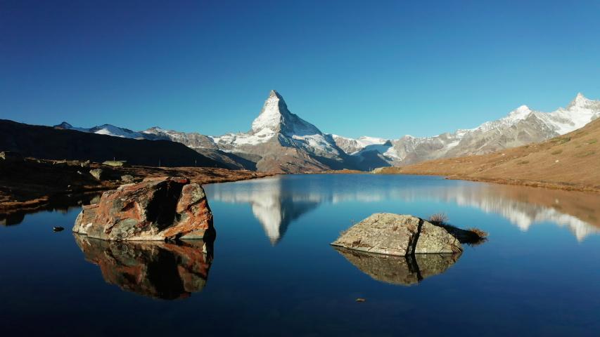 Matterhorn peak reflected in Stellisee Lake in Zermatt, Switzerland. Royalty-Free Stock Footage #1039659494