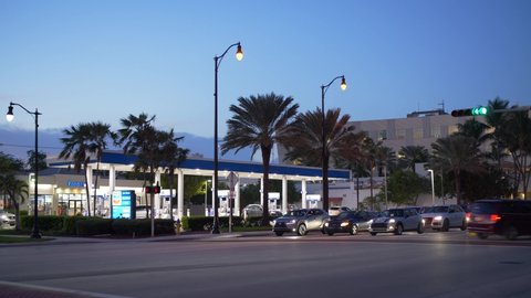 SUNNY ISLES BEACH, FL, USA - OCTOBER 22, 2019: Twilight motion footage of a Chevron Gas Station with traffic in foreground