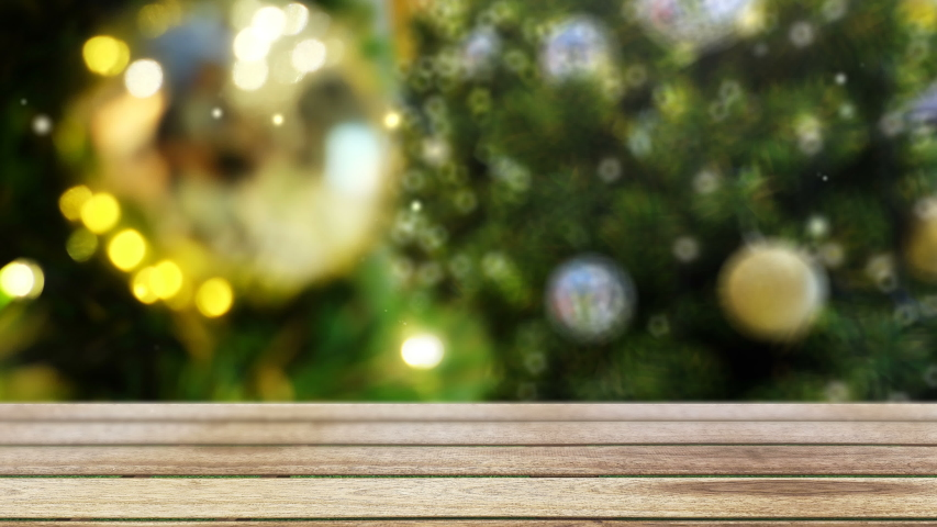 4K. snow falls on wooden table in front of blurry christmas tree decorate with ornament ball and bokeh lighting at background with copy space Royalty-Free Stock Footage #1039710695
