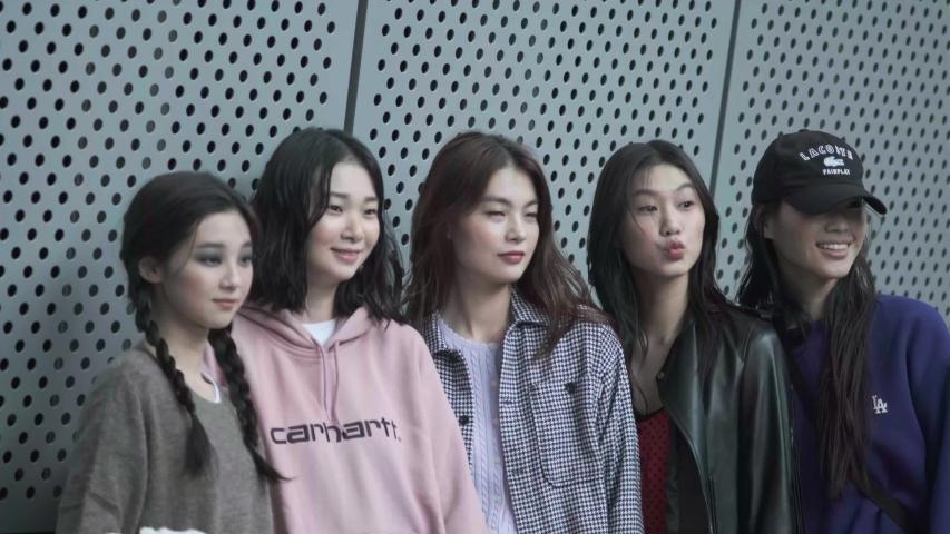 Seoul/South Korea - 2019: Seoul Fashion Week - five Korean models pose for camera #1039735436