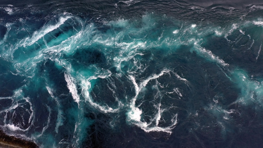 Waves of water of the river and the sea meet each other during high tide and low tide. Whirlpools of the maelstrom of Saltstraumen, Nordland, Norway Royalty-Free Stock Footage #1039778468
