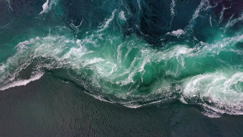 Waves of water of the river and the sea meet each other during high tide and low tide. Whirlpools of the maelstrom of Saltstraumen, Nordland, Norway Royalty-Free Stock Footage #1039778480