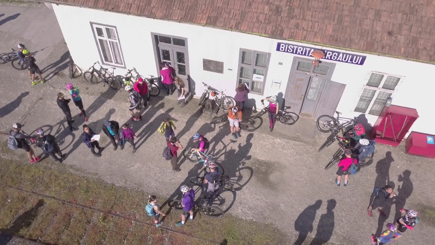 Bistrita / Romania - 06 20 2019: Group of cyclists relaxing on local train station