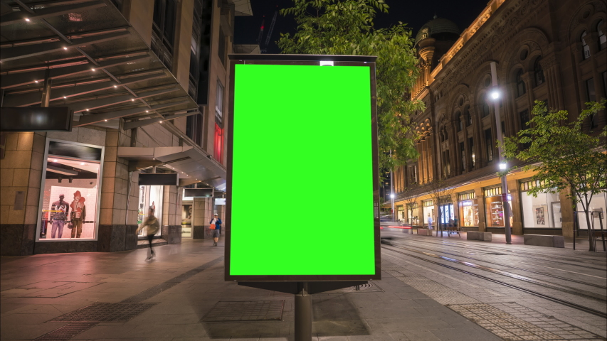 City street Billboard stand with green screen. Time lapse with commuters, people and cars. Space for text or copy. Royalty-Free Stock Footage #1039793213