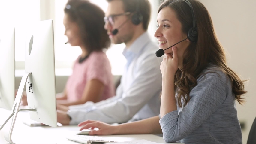 Service phone operators sit at shared desk focus on sales agent woman in headset use pc answers incoming calls talk with client provide professional support to customers sell company product concept