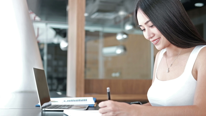 businesswoman working studying writing note at workplace. startup woman entrepreneur looking at watch checking time at office. #1039797614