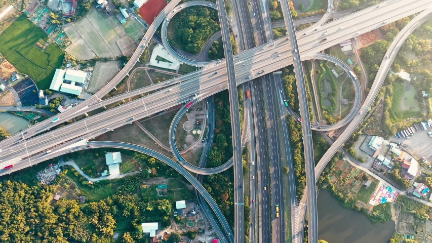 Aerial view of highway interchange - Transport concept footage, busy roads of morning golden hour, birds eye top view use the drone in Pingzhen Interchange System, Taoyuan, Taiwan. | Shutterstock HD Video #1039857938