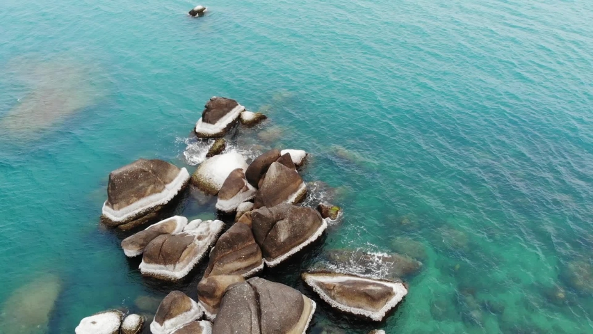 Famous Grandfather and Grandmother Rocks located on shore of blue sea on Koh Samui Island in Thailand. Hin ta Hin yai stones, tourist attraction unusual coastline drone view   Shutterstock HD Video #1039858355