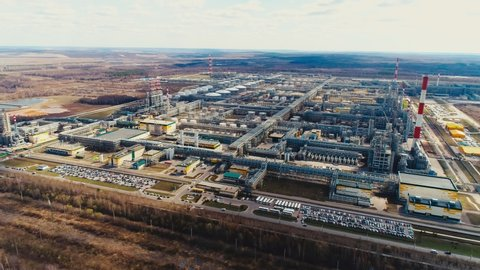 area of gas and oil refinery plant with modern production towers and pipelines system in autumn aerial view