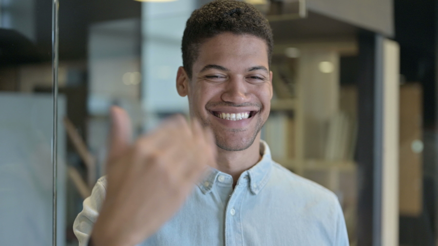 African Man Pointing Finger and Inviting with Hand Gesture | Shutterstock HD Video #1039880690