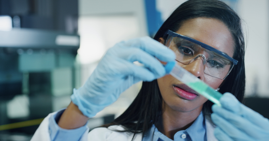 Portrait of dark skin female scientist is analyzing a liquid to extract the DNA and molecules in the test tubes in laboratory.  | Shutterstock HD Video #1039895162