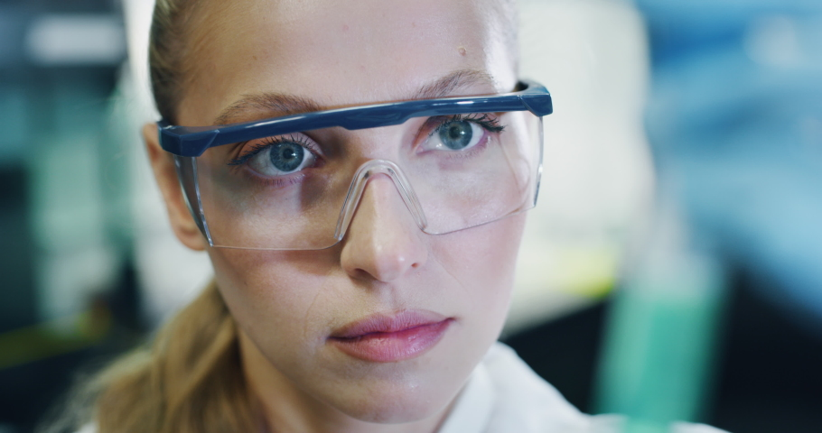 Close up of blond female scientist is analyzing a liquid to extract the DNA and molecules in the test tubes in laboratory.  | Shutterstock HD Video #1039895417