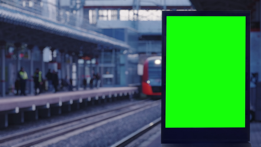Empty modern billboard with a green screen for advertising, on a train station, blank billboard on subway station opposite the train arriving at the platform Royalty-Free Stock Footage #1039900175