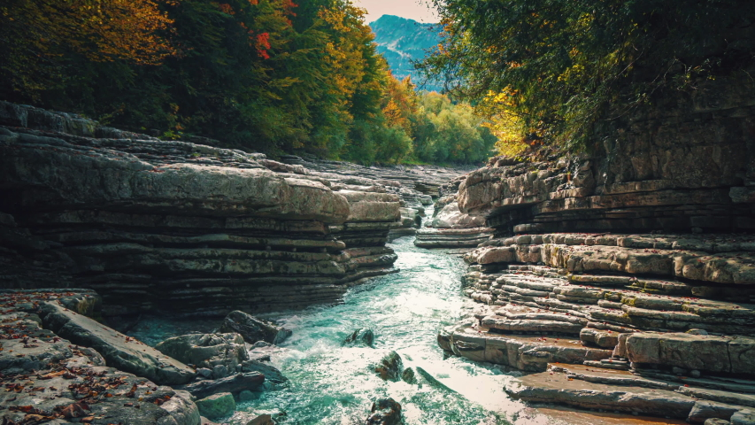 4K UHD Cinemagraph / seamless video loop of the mountain river Taugl in Austria, close to Mozart birthplace Salzburg. The water is rushing through naturally formed rocks.