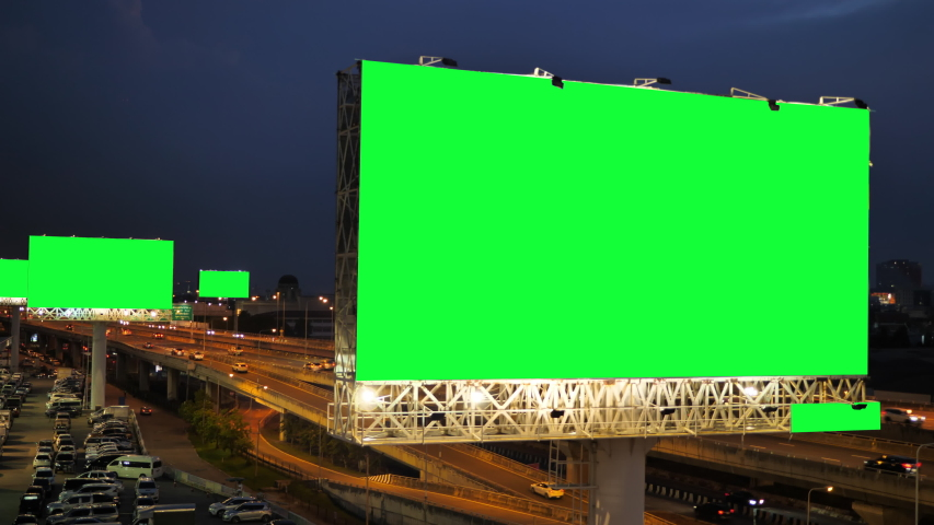 Green screen of advertising billboard on expressway during the twilight with city background in Bangkok, Thailand. | Shutterstock HD Video #1039953728