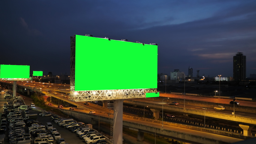 Green screen of advertising billboard on expressway during the twilight with city background in Bangkok, Thailand. | Shutterstock HD Video #1039953737