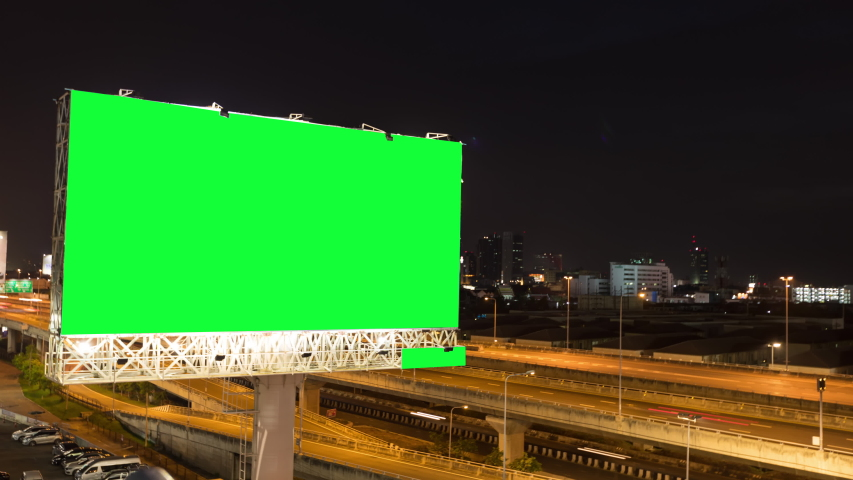Time lapse Green screen of advertising billboard on expressway during the twilight with city background in Bangkok, Thailand. | Shutterstock HD Video #1039953845