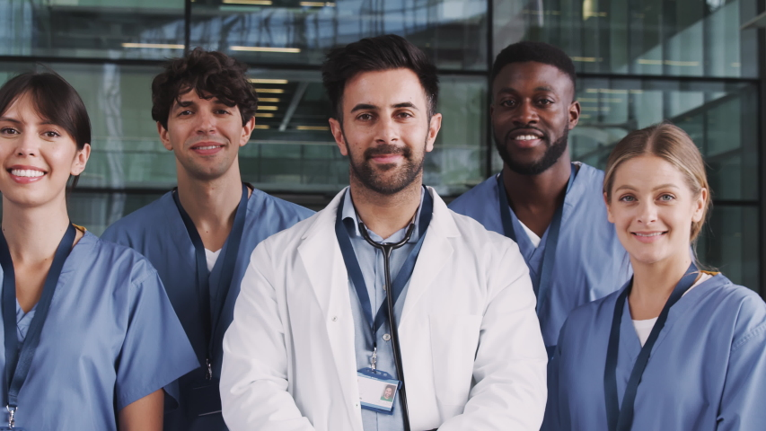 Portrait Of Medical Team Standing In Modern Hospital Building Royalty-Free Stock Footage #1039963271