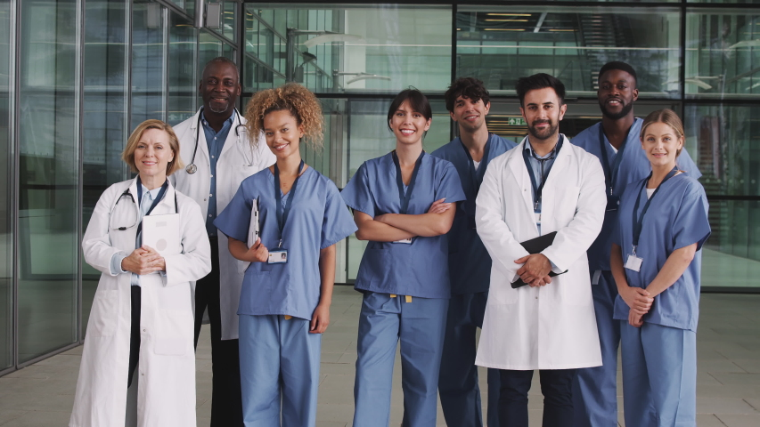 Portrait Of Medical Team Standing In Modern Hospital Building