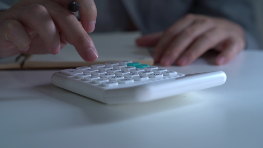Finance technology, hand of working man using calculator for solving his mathematics problem | Shutterstock HD Video #1039978037