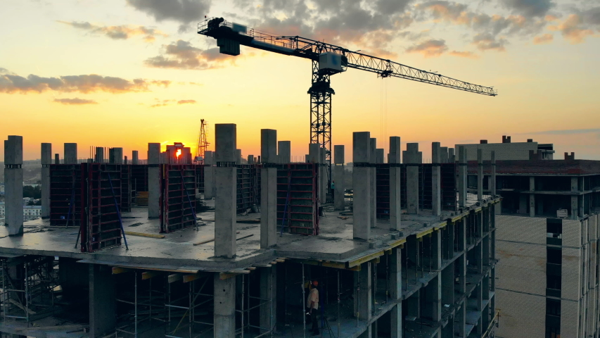 Big crane works with unfinished building. | Shutterstock HD Video #1040002274