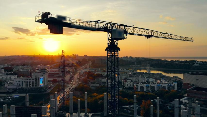 Metal crane on a building site. | Shutterstock HD Video #1040006483