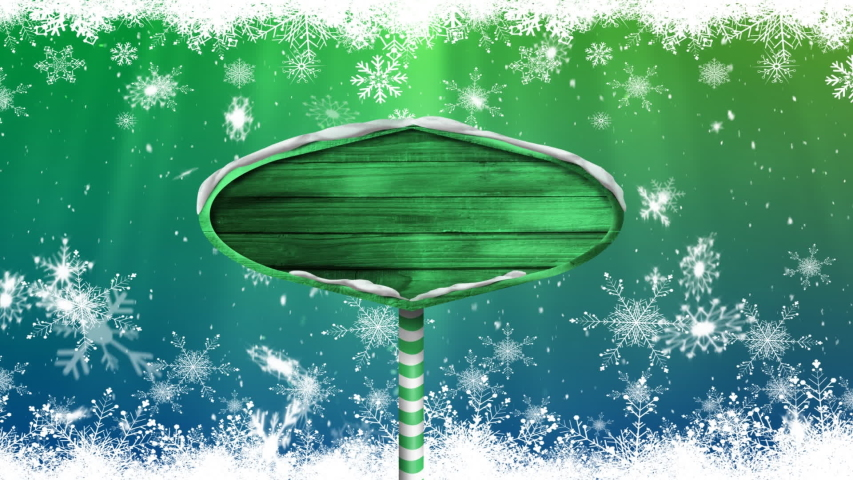 Animation of snowflakes falling and green wooden sign board on green to blue background | Shutterstock HD Video #1040113487