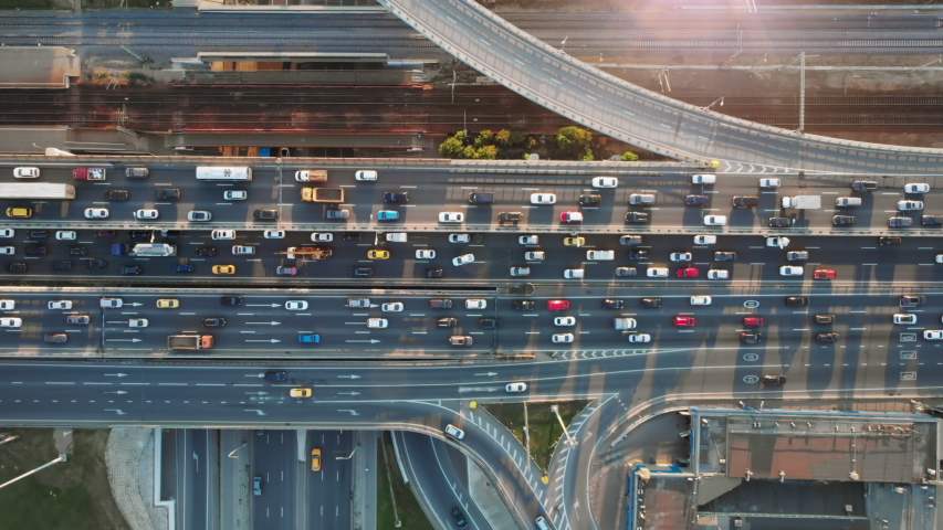 Beautiful aerial view to the cars driving on multi-level highway in Moscow. Direct view from above to the road traffic in a big city on the sunny evening.