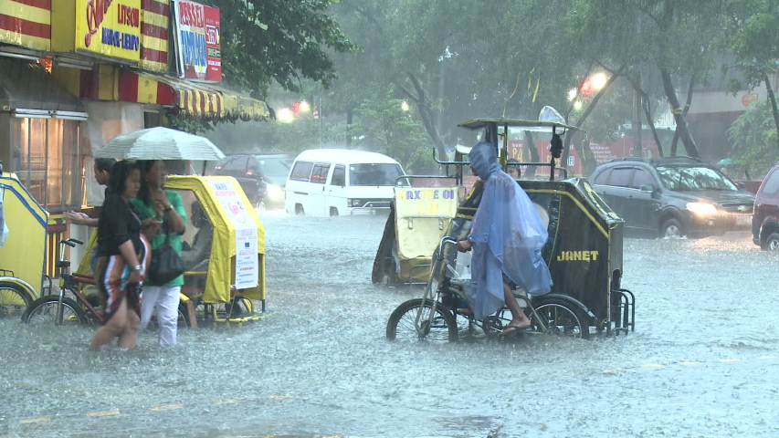 MANILA, PHILIPPINES - AUGUST 2012: Streets Underwater As Monsoon Rain Floods Manila