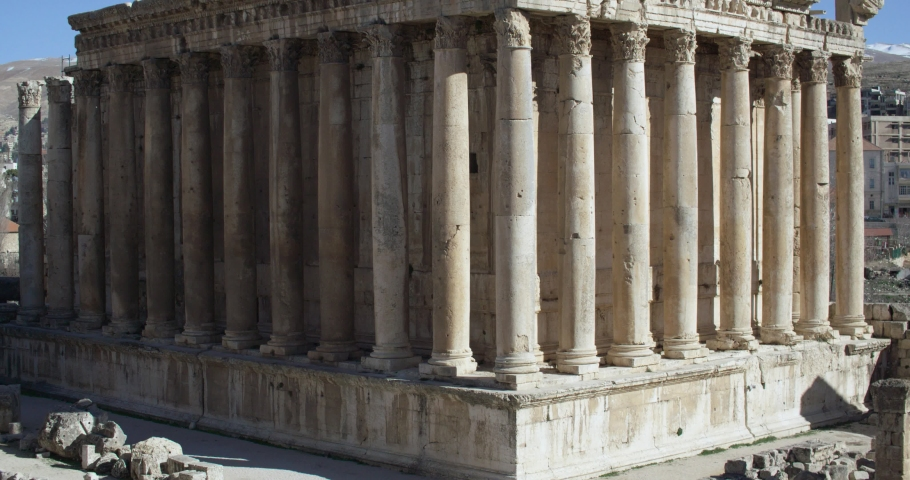 Tilt up on Temple of Bacchus, Baalbek's Roman ruins, Lebanon. Baalbek Roman ruins, an UNESCO world heritage, contains some of the best preserved Roman ruins in Lebanon | Shutterstock HD Video #1040136203