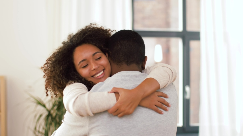 Love, relationships and people concept - happy african american couple hugging at home | Shutterstock HD Video #1040141777